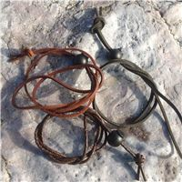 Windstrap securing leather cords